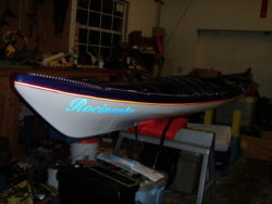Rocinante in low light. Reflective perimeter lines, pin-striping and reflective boat name decal.