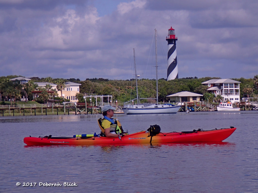 St Augustine Lighthouse and beautiful sailboats at anchor