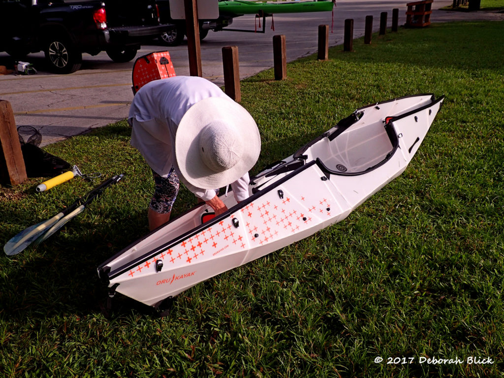 Assembling an Oru Bay origami kayak at the put-in