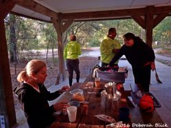 Getting ready for breakfast in the cooking pavilion at the Woods Ferry River Camp.