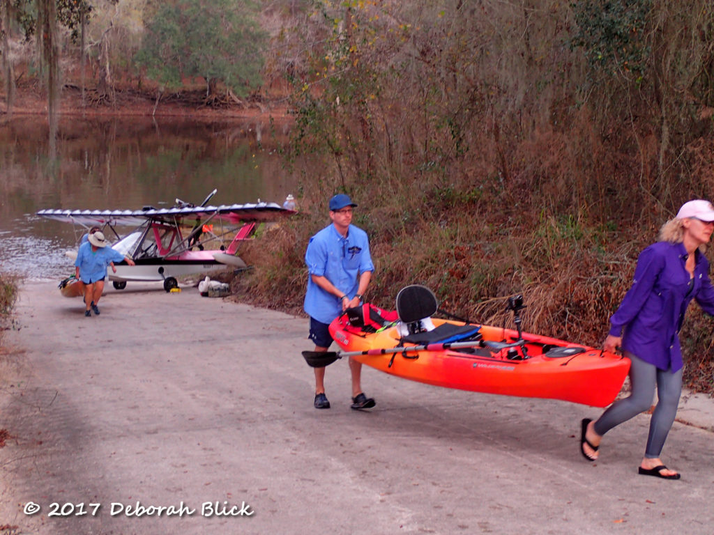 Hauling our kayaks around the ultralight plane on the boat ramp