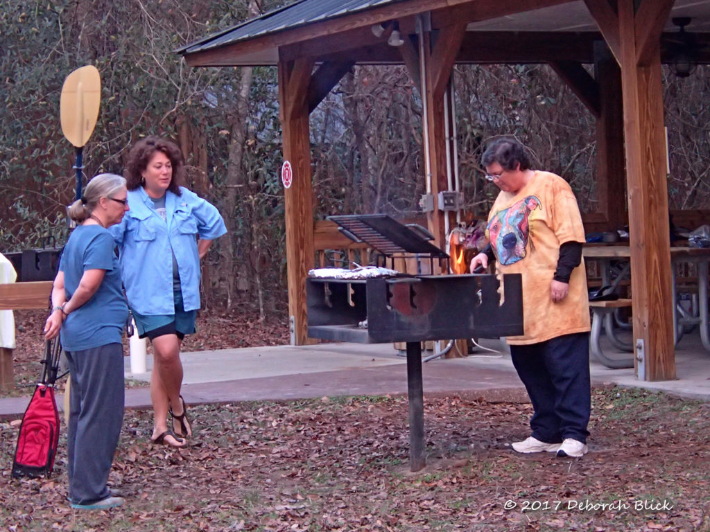 Cooking on the grills at the picnic pavilion at Peacock Slough River Camp
