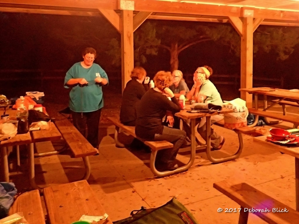 Hanging out in the picnic pavilion after dinner at Adams Tract River Camp