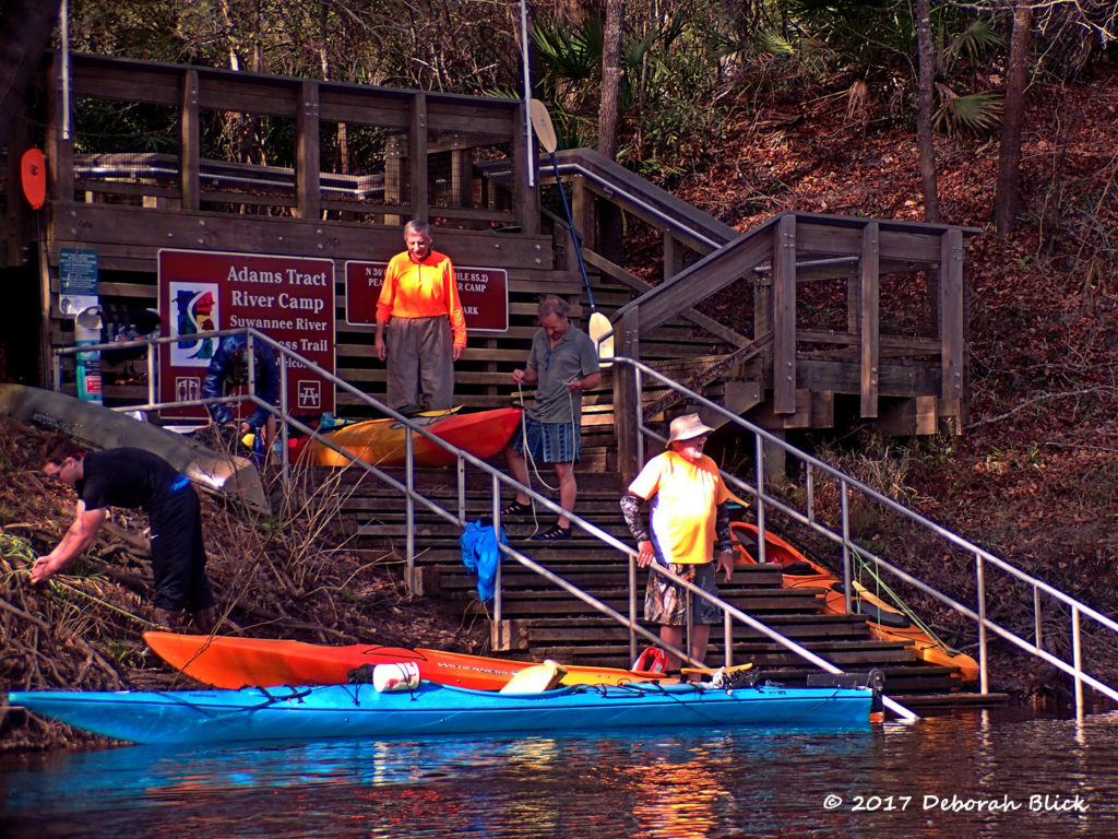 Loading up on the stairs at Adams Tract River Camp - one kayak at a time